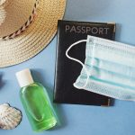 Lifting travel restrictions after the coronavirus epidemic. Sun hat, passport, sanitizer gel for washing hands and face mask